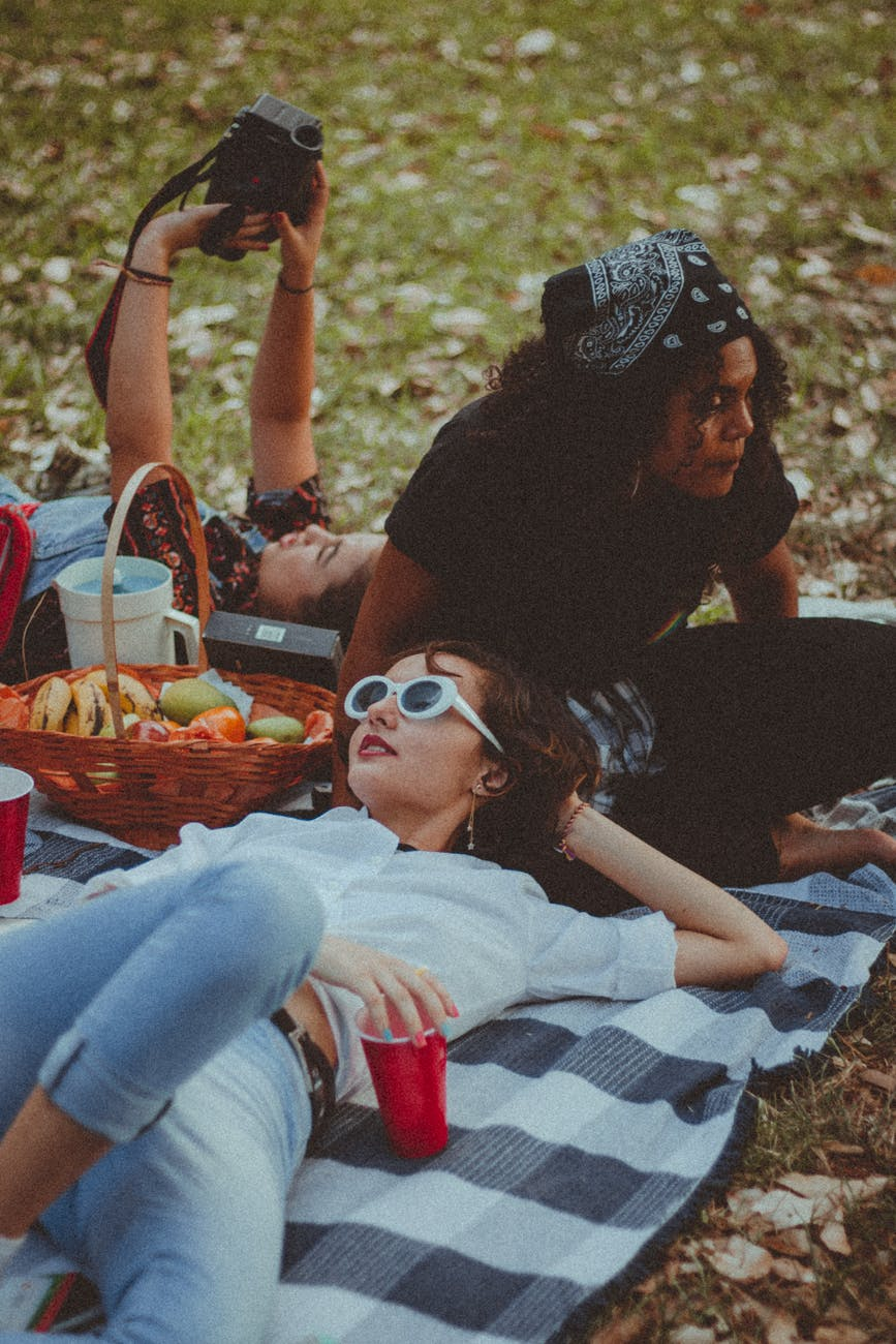 three women having a picnic